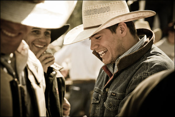 Cowboy Photography; laughing with his friends.