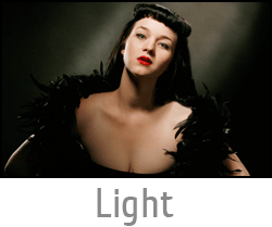 "Image button of woman bathed in old style beautiful Hollywood Glamour Lighting with text ""Light"" and link to Beautiful Light page."