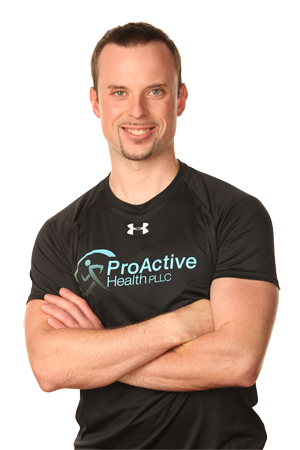 Example of a knockout headshot, Proactive Health owner standing with his arms crossed, and no background.