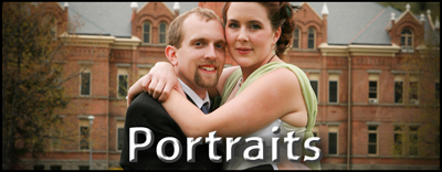 Portrait of young bride and groom in front of University Hall.