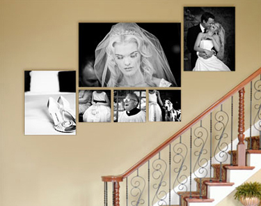 Cluster of wedding images displayed on the wall going up stairs.
