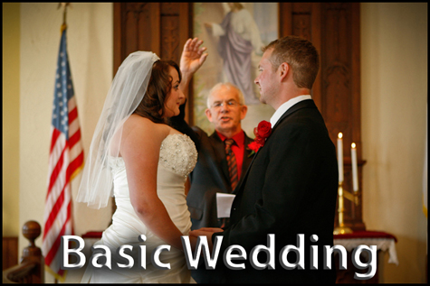 Basic Wedding Package. Minister holding up ring with young couple in small country church.