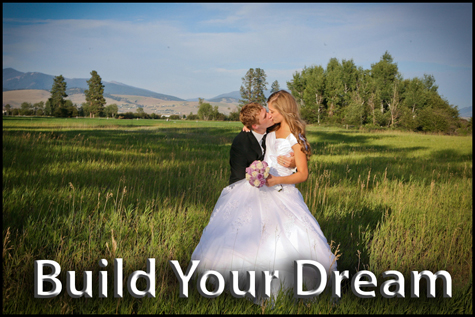 Groom kissing the bride in a field surrounded by beautiful mountains. Build Your Dream Button