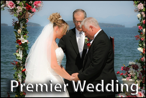 Couple bowing to each other in prayer on the shore of mountain lake.  Premier Wedding Package Button